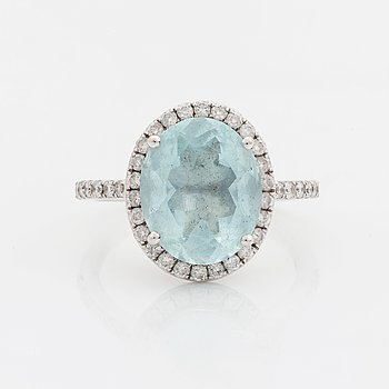 Aquamarine and brilliant cut diamond ring.