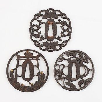Three Japanese iron tsubas, Edo, 19th century.