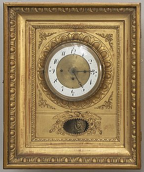 A late Empire gilded wall clock mid 1800s.