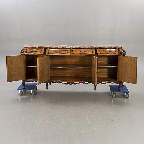 A louis xv style birch sideboard first half of the 20th century.