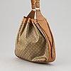 Céline, a canvas and leather bag.