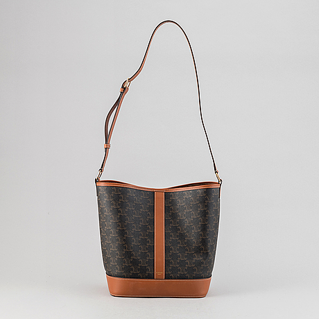 Céline, a canvas and leather handbag and wallet, 2020.