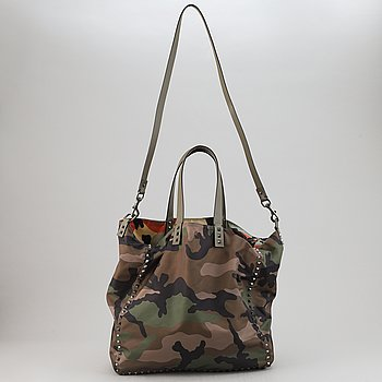 Valentino, a reversible nylon and leather handbag.
