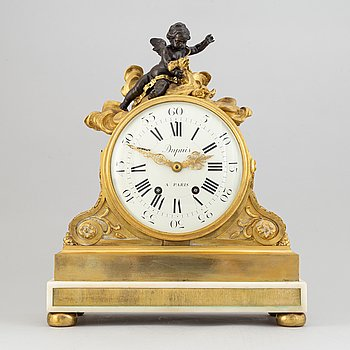 A French Louis XVI-style gilt bronze mantel clock, later half of the 19th Century.