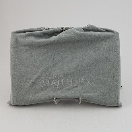 Alexander mcqueen, a fabric clutch.