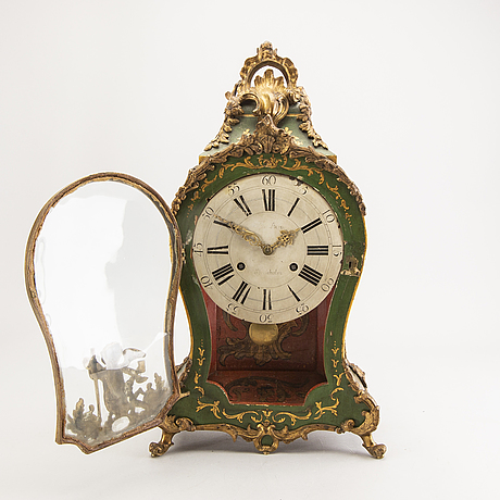 A swedish painted rococo wall clock mark of c berg stockholm.