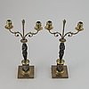 A pair of brass empire style candle holders, 20th century.