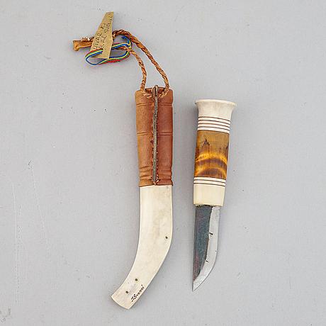 Ingvar svonni, a reindeer horn, birch and leather sami knife, signed i svonni.