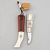 Bruno johansson, a reindeer horn and leather sami knife, signed bj.