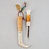 Lennart sammelin, a reindeer horn, birch and leather sami knife, signed ls.