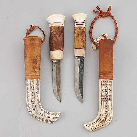 Two reindeerhorn, letaher and birch sami knives, signed.
