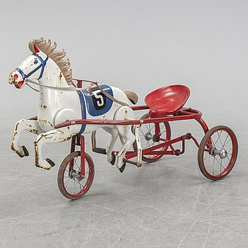 A mid 20th Century child's pedal horse and sulky.