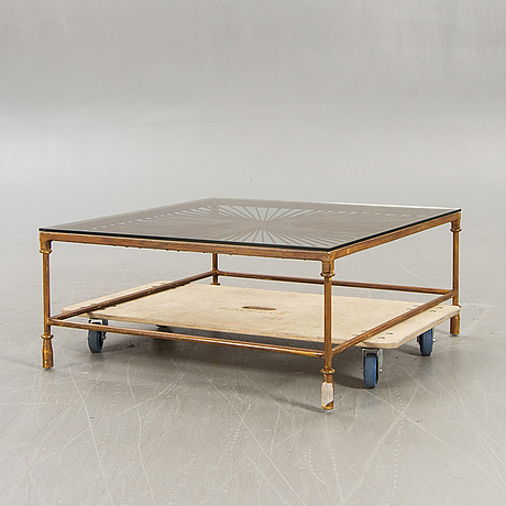 A late 20th century metall and glass coffee table.