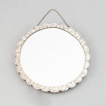 A silver mirror, probablynCarlo Mario Camusso, Lima, Peru.