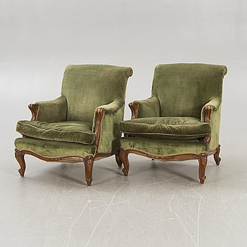 A pair of Rococo style armchairs mid-20th century.