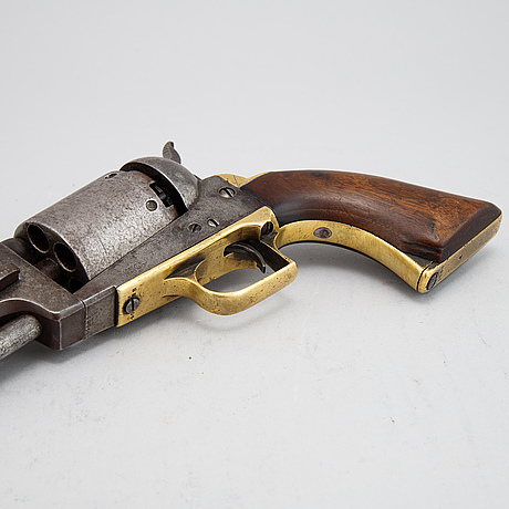 A colt dragoon first model percussion revolver with replacement barrel with british marks. serial no on other parts 4088.