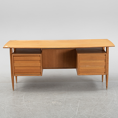 A teak veneered writing desk, 1950's/60's.