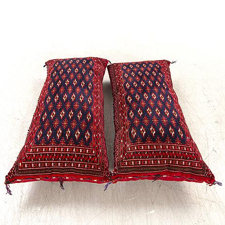 A pair of tekke turkmen cushions 125x58 cm each.
