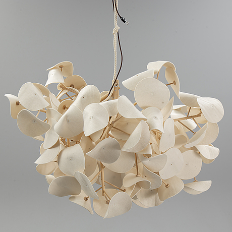 A contemporary birch and wool 'leaf lamp' by peter schumacher, green furniture concept.