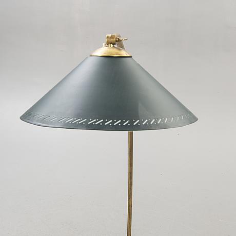 A 1950s brass floor lamp.