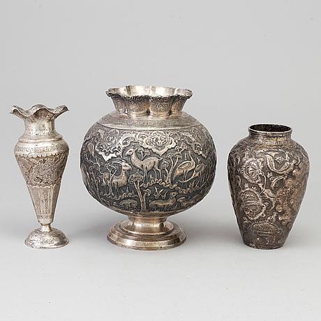 Three silver vases, the 20th century.