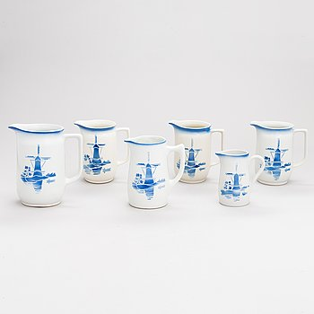 A set of six ceramic milk jugs by Arabia, Finland 1930s-40s.