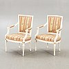 A pair of swedish painted late gustavian armchairs around 1800.
