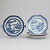 A set of three blue and white plates and a hot water dish, qing dynasty, 18th/19th century.