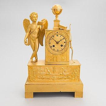 A French mantel clock, circa 1840s.