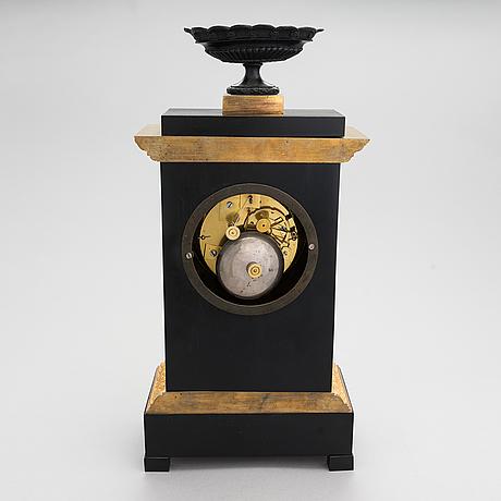 A fench late empire pendulum clock, ca 1830-40s.