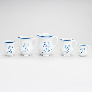 A set of five ceramic milk jugs by Arabia, Finland 1930s-40s.
