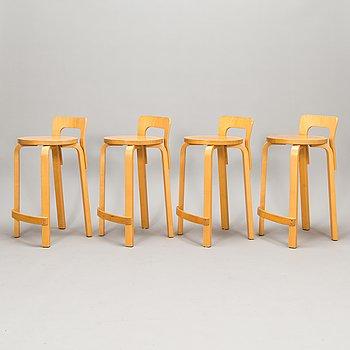 Alvar Aalto, A set of four K65 bar stools, Artek, Finland, late 20th century.