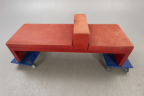 An italian leather bench later part of the 20th century.