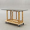 A probably italien bamboo and rattan table later part of the 20th century.