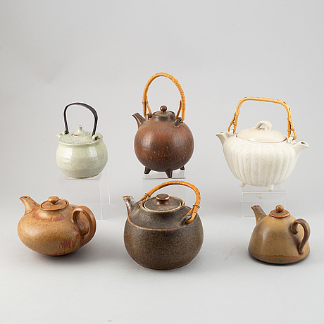 Gunnar nylund, a set of four stoneware teapots and carl-harry stålhane, two teapots, rörstrand.