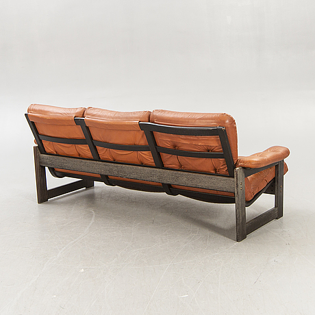 A leolux 1970s leather and  wood sofa.