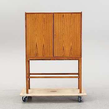 A 1950's/60's rosewood bar cabinet.