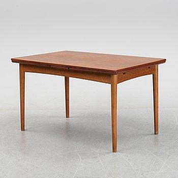 A teak veneered dinner table, mid 20th Century.