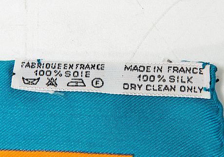 Hermès, a 'sangles' silk scarf.