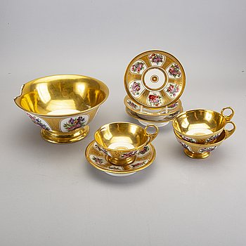A set of four pcs of gilded cups and saucers and a bowl marked Scholcher mid 1800s.