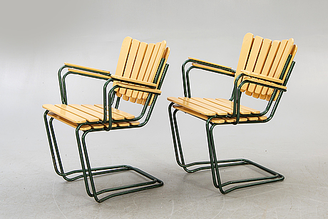 A set of four mid 1900s garden chairs.