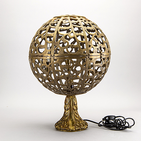 An oriental brass table lamp later part of the 20th century.