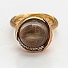 """Ole lynggaard, """"lotus"""", an 18k gold ring with a rutile quartz and diamonds ca. 0.065 ct in total."""