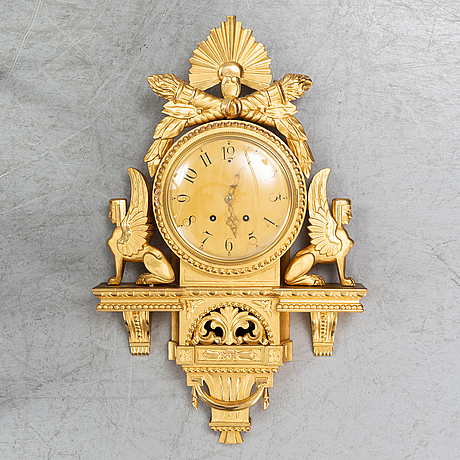A 20th century empire style giltwood wall clock.