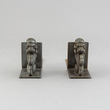 A pair of brass book ends, stjärnmetall, 1930's.