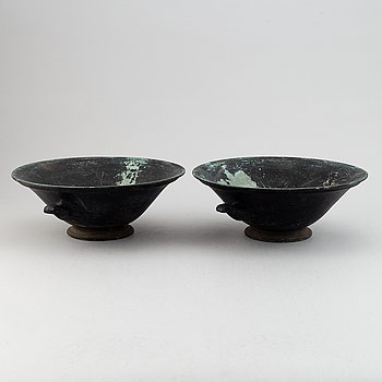 A pair of cast iron urn, first half of the 20th century.