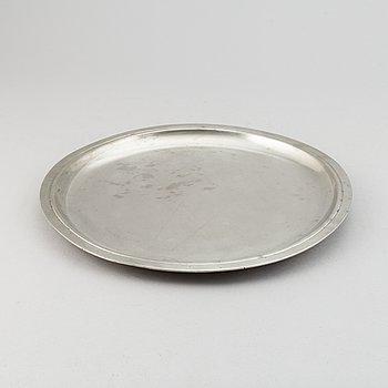 A pewter tray/plate from Firma Svenskt Tenn, Stockholm, 1934.