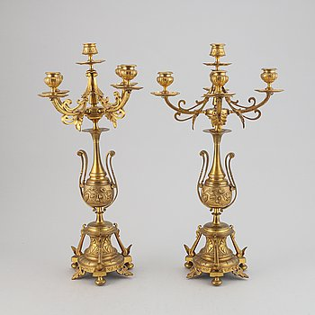 A pair of late 19th century brass candelabra for five candles.