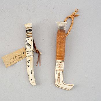 Two Sami reindeer horn knives. One by Erik Svenni rautas, one probably by Viliam Eriksson, Flakaberg.