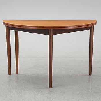 A mid 20th century teak table from Frem Rølje.